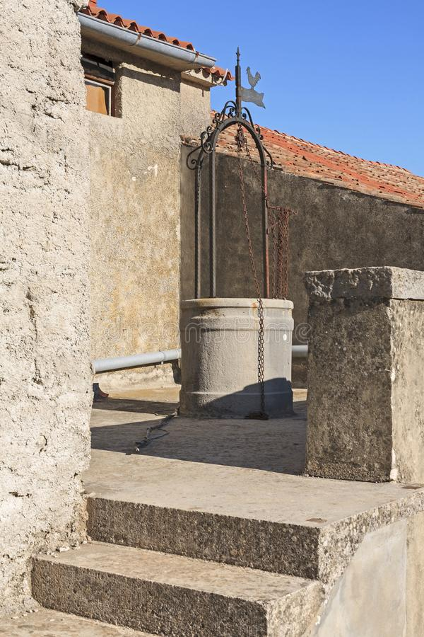 Draw well in Istria. In arid areas of Istria rainwater is collected in cisterns. With the help of draw wells, the water supply is then ensured royalty free stock images