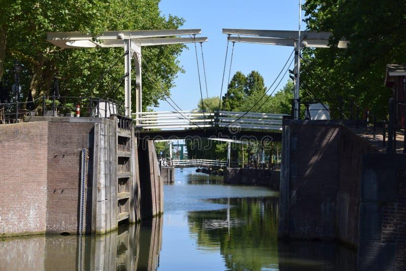 Drawbridge at de Oude Sluis at Vreeswijk, Nieuwegein, Utrecht, the Netherlands. Old wooden drawbridge at the old city centre Vreeswijk, Nieuwegein nearby Utrecht stock photo