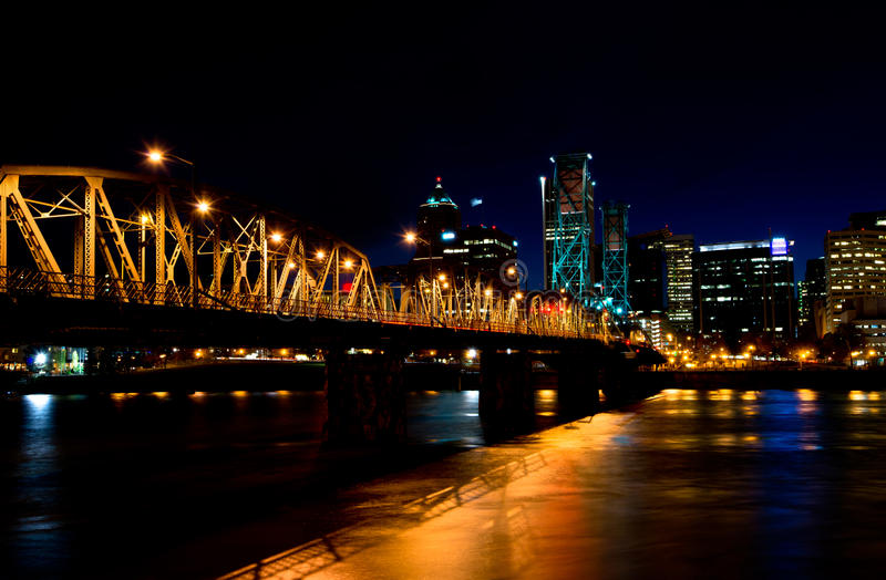 Drawbridge in the night lights of Portland downtown. Portland Night shining lights lit bridge over the Willamette river and embankment with skyscrapers on the royalty free stock image
