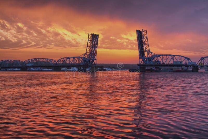 Drawbridge over Sturgeon Bay. The bridge that runs across Sturgeon Bay, Wisconsin is open at sunset stock photos