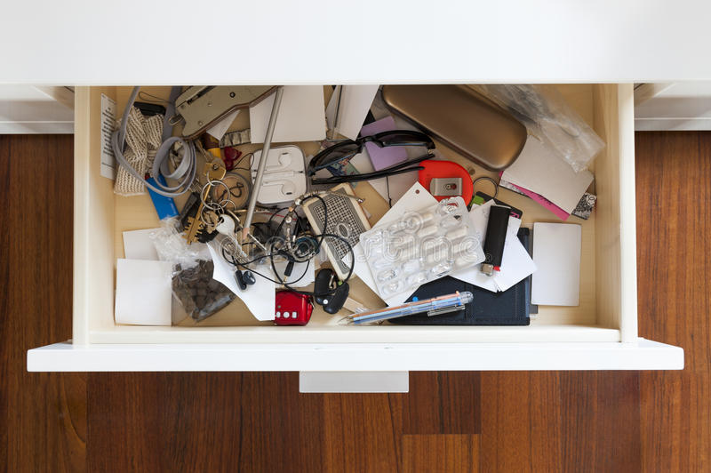 Drawer. With a lot of personal items piled up in disarray stock photo