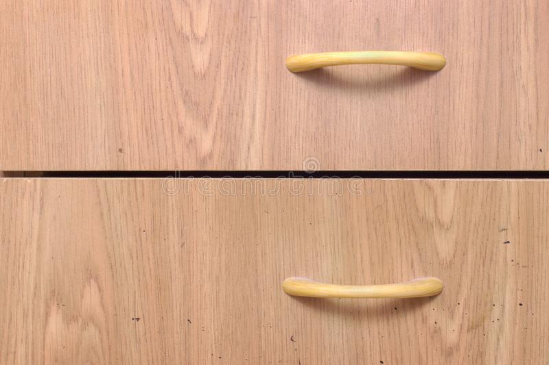 Drawer pull handle. imitation of wood texture. Drawer pull handle. bow-type, plastic, made in form of arcs, imitation of wood texture. front surface of furniture royalty free stock image