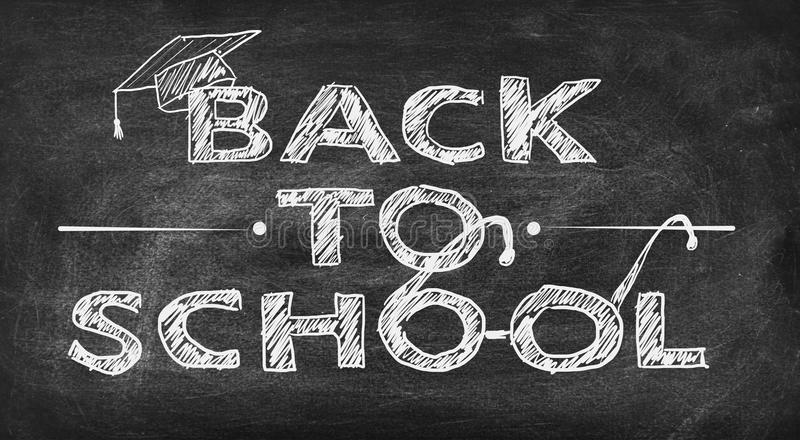 Drawing back to school. On black chalk board stock image