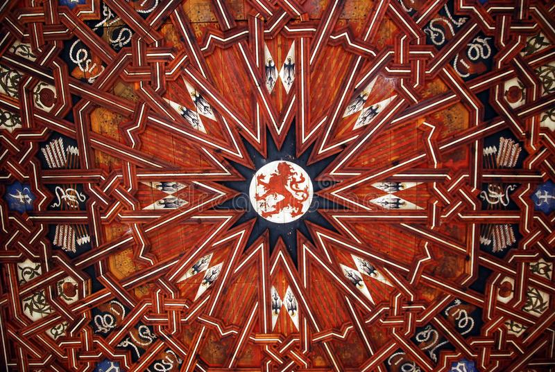 Drawing on the ceiling in the basilica. Symmetric composition. Wooden parts under the roof stock photography