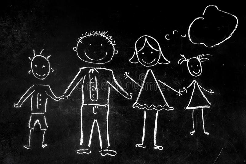 Drawing with chalk on the black background of the family stock photo