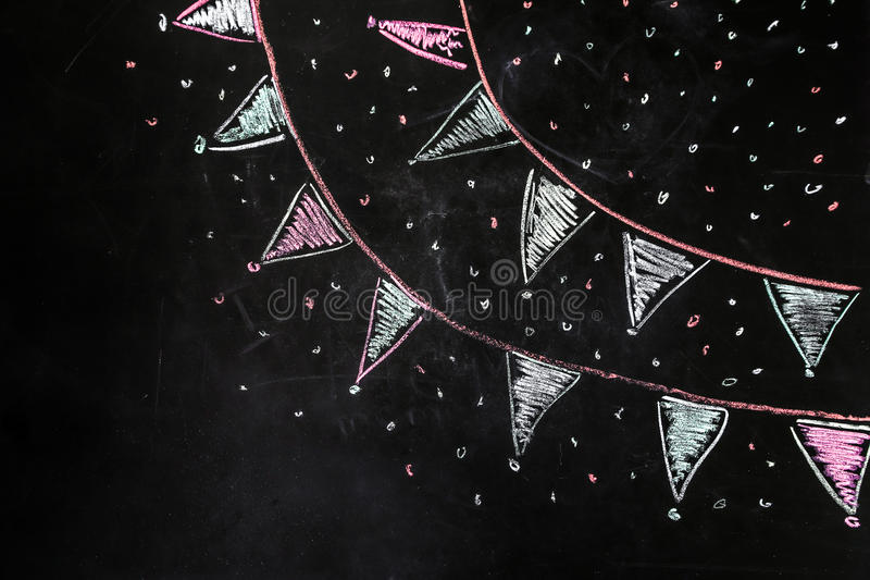 Drawing chalk flags on the black background. The concept of friendship and celebration stock image