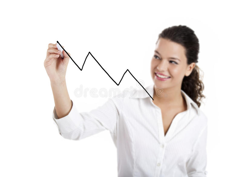 Drawing a chart. Young businesswoman drawing a chart isolated on white background stock photography