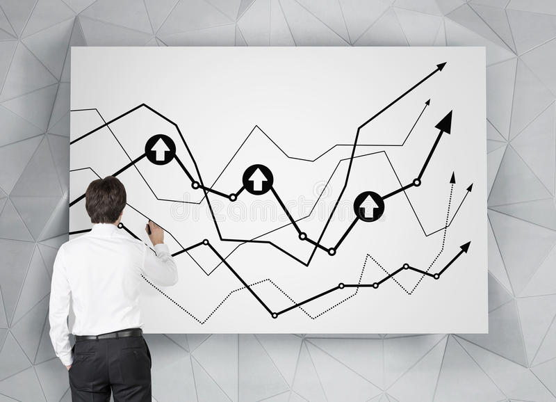 Drawing chart. Businessman in room drawing chart on poster royalty free stock images