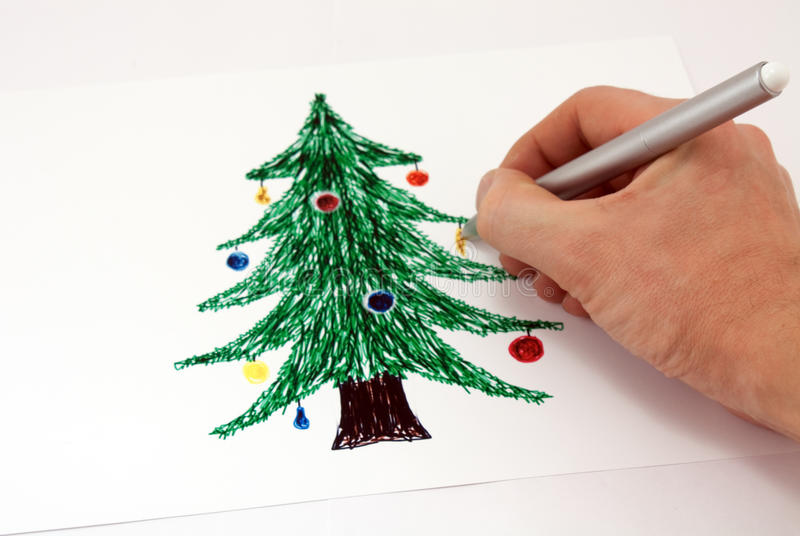 Drawing a Christmas tree markers stock photography