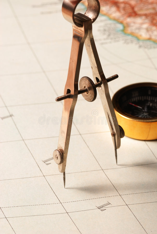 Drawing compass on a map royalty free stock photography