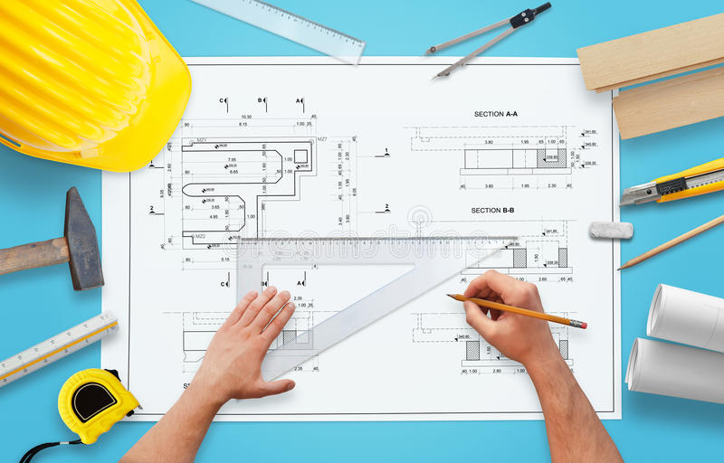 Drawing construction project. Tools and equipment arranged around the plan.  stock image