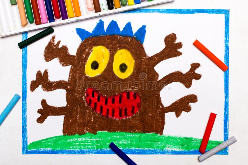 Drawing: Cute brown monster with six hands royalty free stock photo