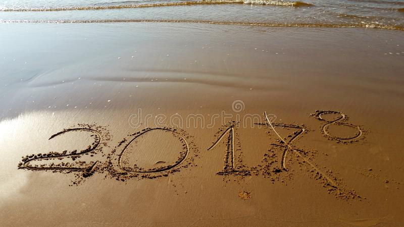 Numbers 2018 drawn in the beach royalty free stock image
