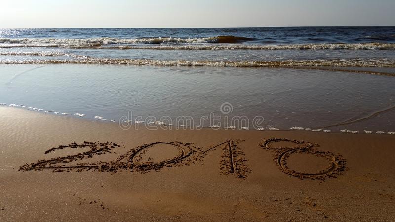 Numbers 2018 drawn in the beach stock photos