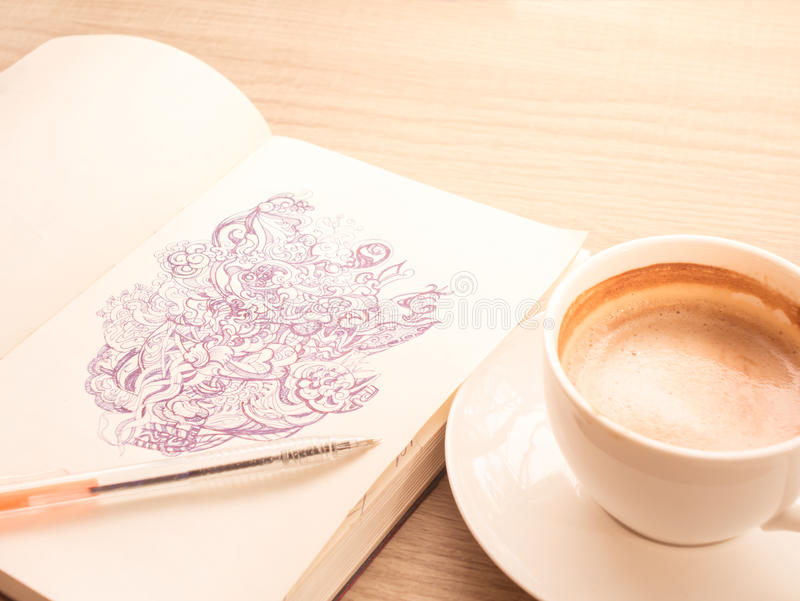 Drawing Doodle line art by black ink on paper with coffee. Closeup drawing doodle line art by black ink on paper with coofee cup royalty free stock images