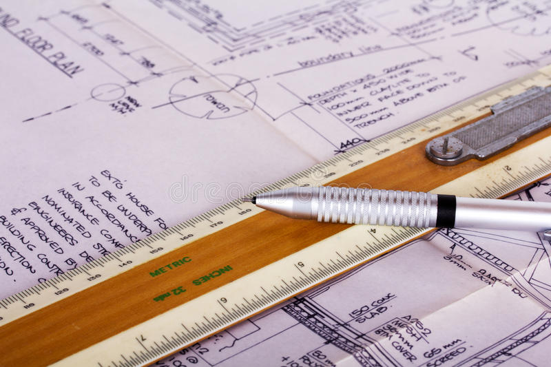 Drawing equipment with detailed architects house plans stock image
