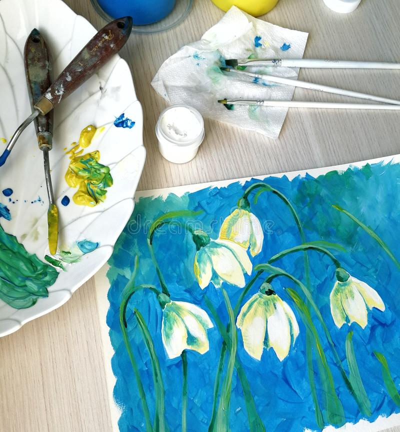 Drawing with flowers, drawn by professional artistic materials of watercolor and gouache, close-up canvas, palette and stock image