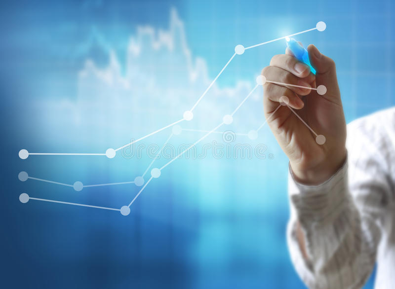 Drawing graphics a growing graph. Businessman drawing graphics a growing graph stock photography