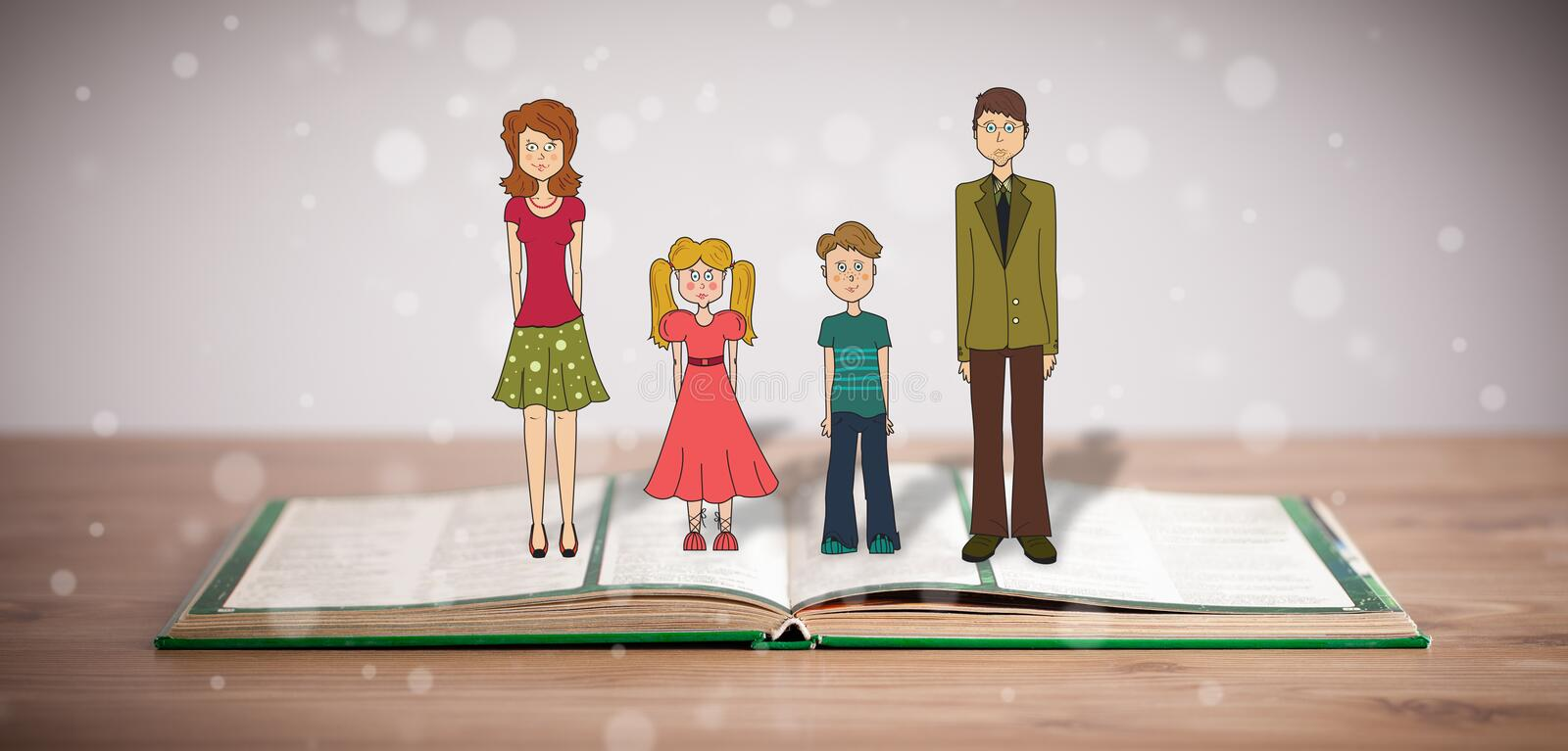 Drawing of a happy family on opened book stock images