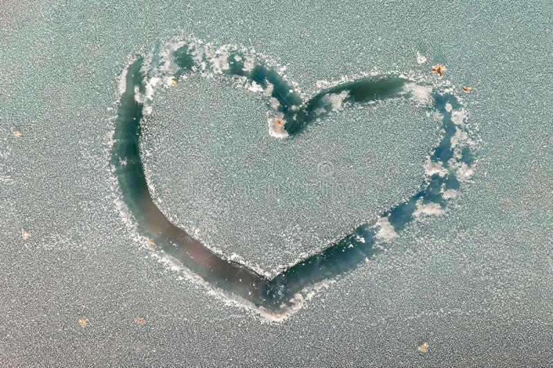 The drawing of the heart on the glass by hoarfrost.  stock images