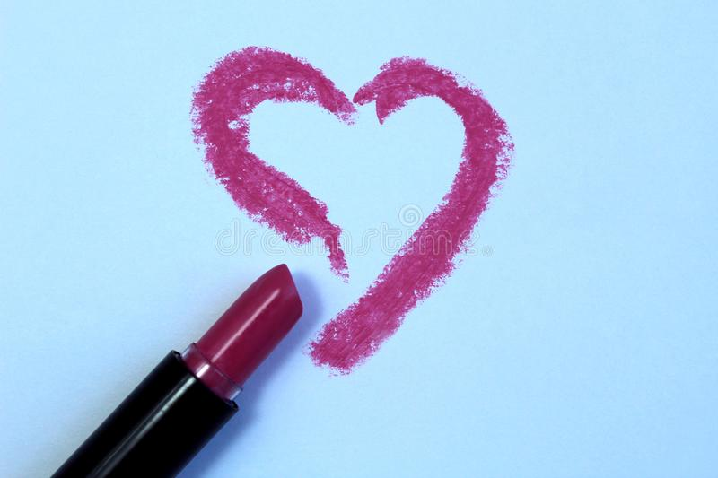 Drawing heart with lipstick on white paper, top view. 14, emotions, artistic, background picture, card, celebration, closeup, concept, creative, decor, intent stock photography
