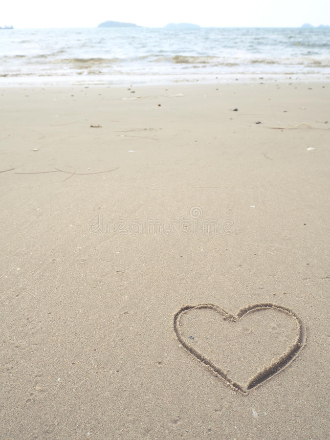Drawing heart shape on the beach. In the low tide royalty free stock photos