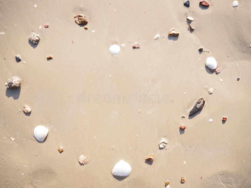 Drawing heart shape on the beach. In the low tide royalty free stock images