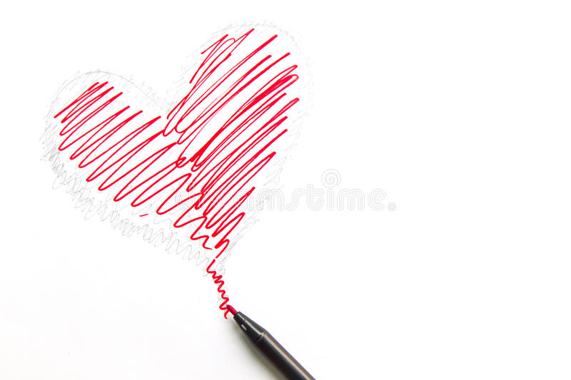 Drawing heart shape with pen isolated on white background royalty free stock photos