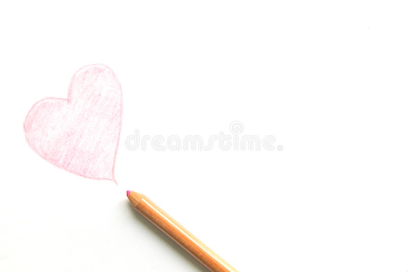 Drawing heart shape with pencil isolated on white background.  stock images