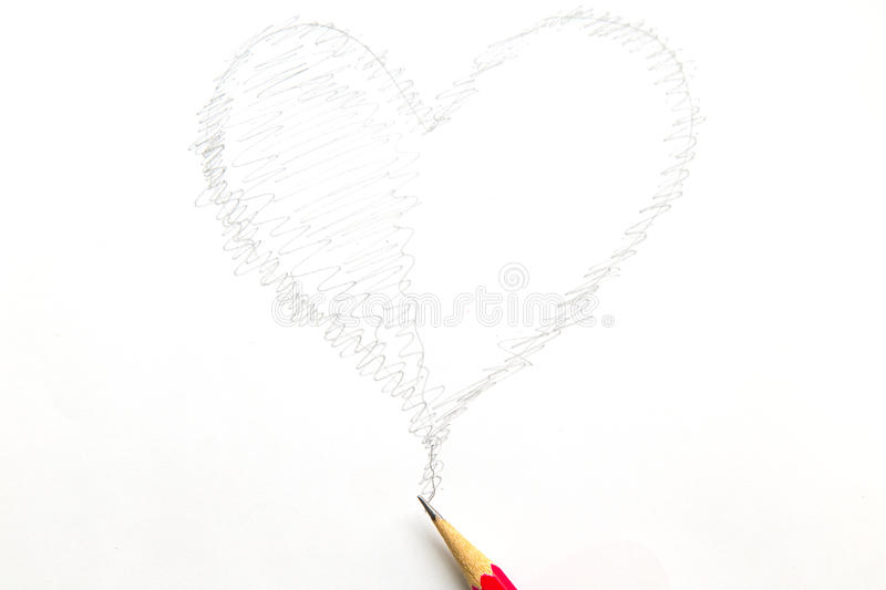 Drawing heart shape with pencil isolated on white background.  royalty free stock photos