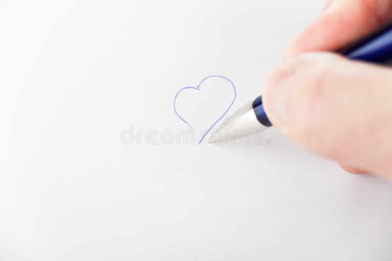 Drawing heart. On white paper royalty free stock photo