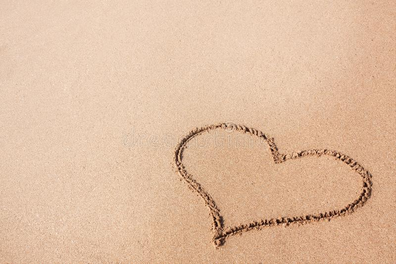 Drawing of a Heart on a Yellow Sand Beach. Drawing of a Heart on a Yellow Sand Beach extreme closeup royalty free stock image
