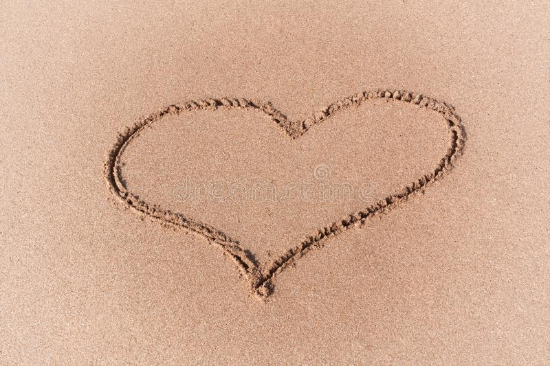 Drawing of a Heart on a Yellow Sand Beach. Drawing of a Heart on a Yellow Sand Beach extreme closeup stock images