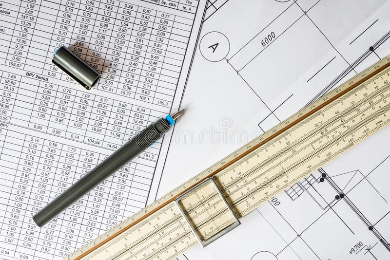 Drawing house plan, slide rule and pencil on the table. Draw a diagram, tools for sketching on the table, a ruler and pen royalty free stock photo