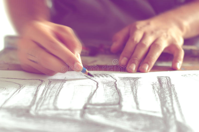 Drawing human figure with a pencil, blurred movement. royalty free stock photos