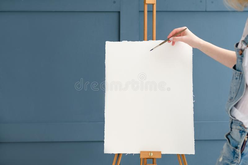 Drawing lesson art class paint school blank paper. Drawing lessons. art classes. painting school. learn to create pictures. woman starting to draw on blank royalty free stock images