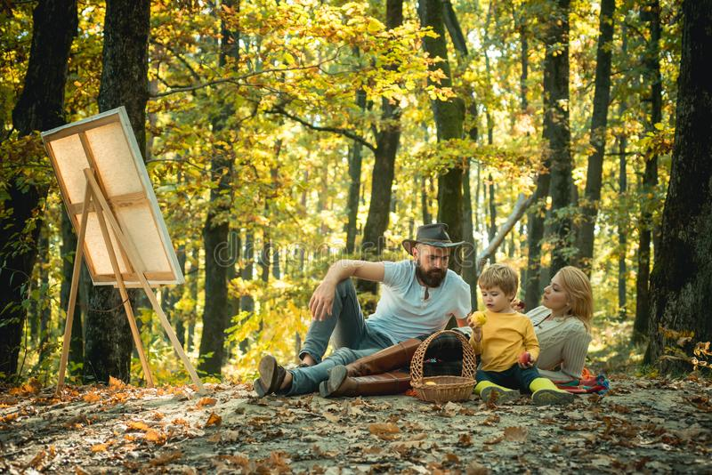 Drawing from life. Painter artist with family relaxing in forest. Painting in nature. Start new picture. Capture moment. Beauty of nature. Woman bearded men royalty free stock photos