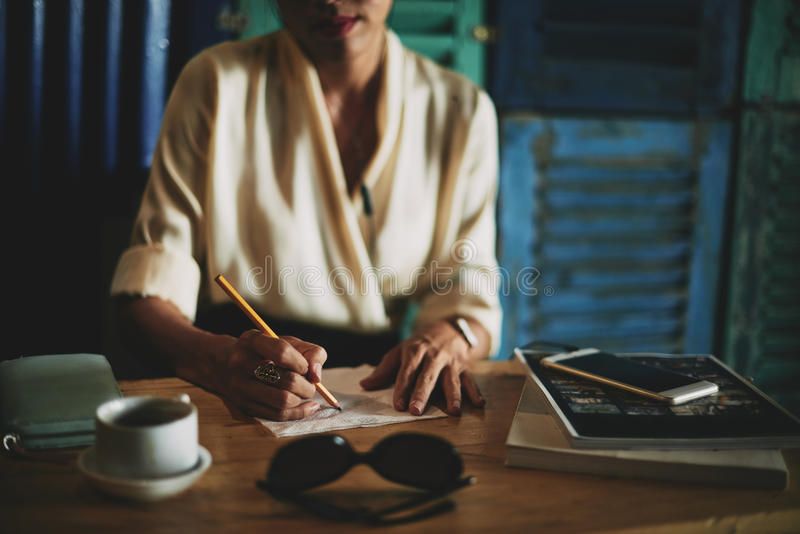 Drawing on napking. Close-up image of business lady drawing ideas on a napkin, selective focus stock photo