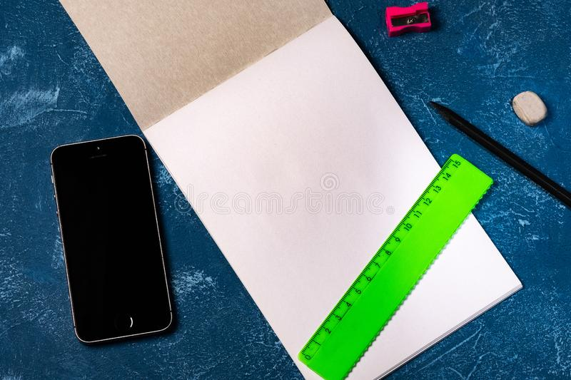 Drawing pad and  on blue background royalty free stock photos