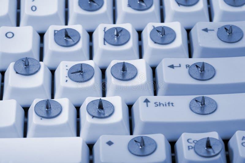 Drawing pin and keyboard royalty free stock image