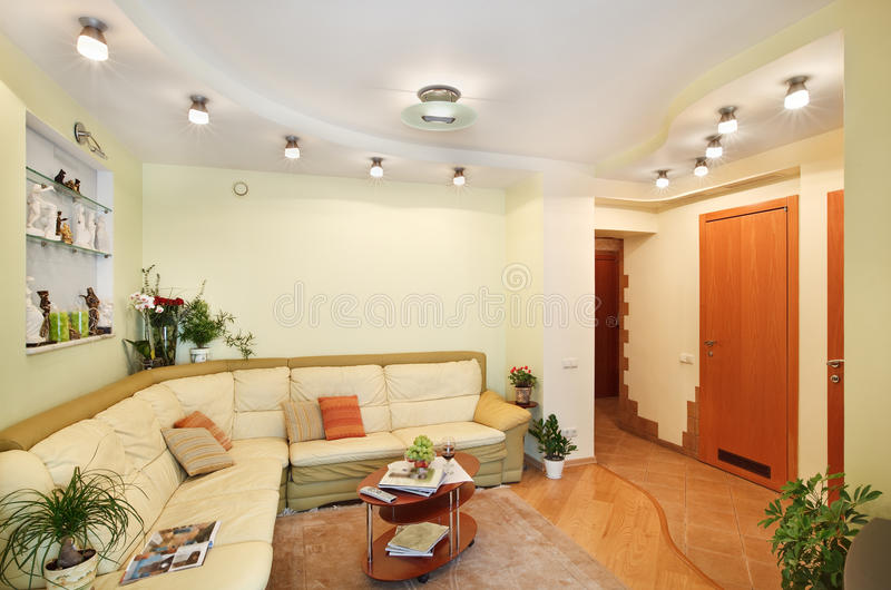 Drawing-room with beige leather Sofa and Passage royalty free stock photos