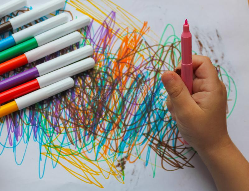 Drawing, a small child. colored felt-tip pens, felt-tip pen in h royalty free stock photos