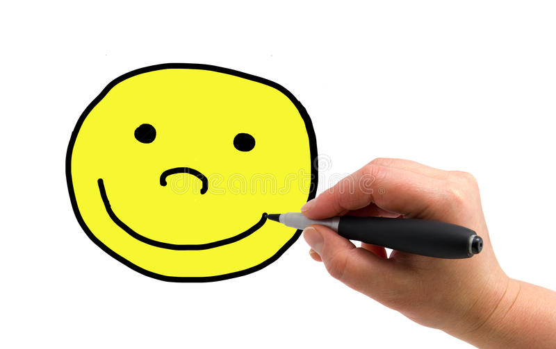 Drawing smiley. Illustration of the hand with a pen drawing smiley on the white paper background stock photos
