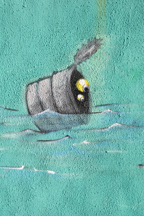 Drawing of tin with two eyes into water. On wall stock photos