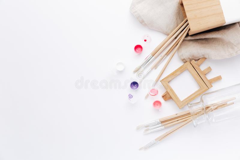 Drawing tools, stationary supplies, workplace of artist. Watercolor paints on white background. Flat lay royalty free stock photos