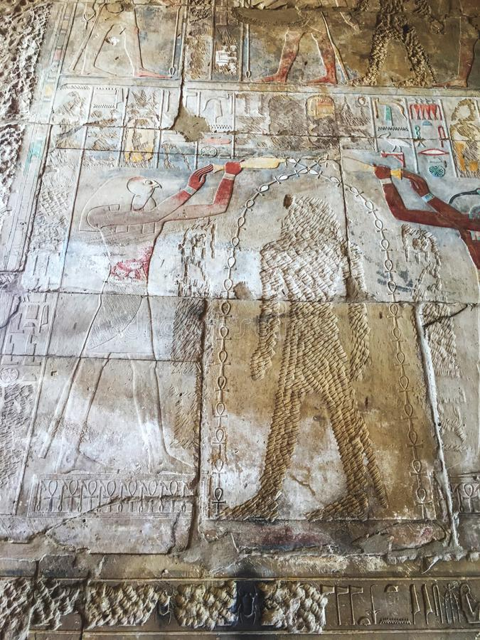 Drawing on the wall of the temple of pharaohs in Luxor. Egypt. Drawing on the wall of the temple of pharaohs in Luxor, Egypt royalty free stock image