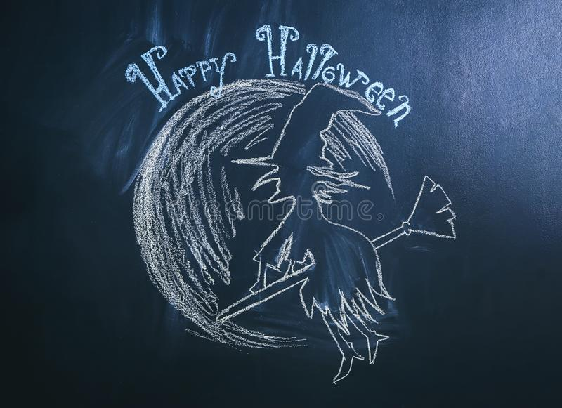 Drawing of witch with text \'Happy Halloween\' on dark background royalty free stock photo