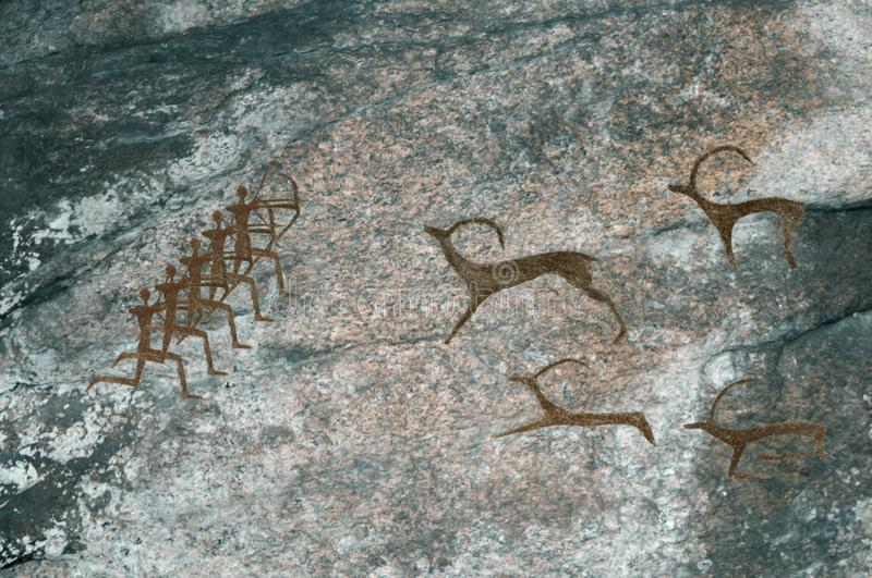 Drawings in the cave. Prehistoric people hunt animals. Caveman, Neanderthal, primitive, aboriginal. The Stone Age stock photo