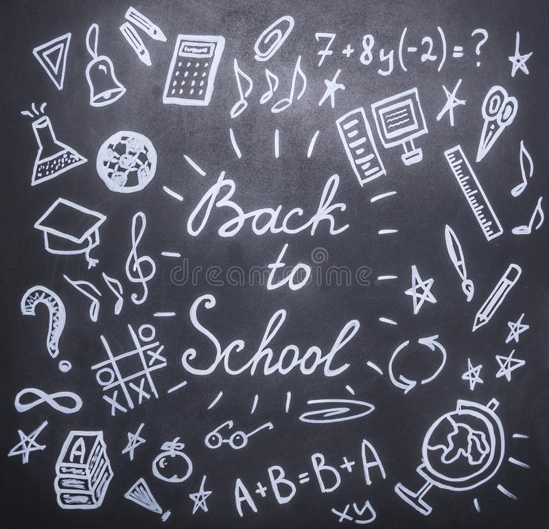 Drawings the chalkboard on the new academic year, fall, school supplies stock photos