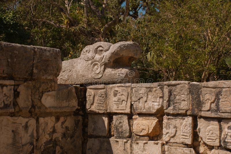 Drawings of skull on the stone of the Maya.The texture of the stone. Chichen-Itza, Mexico. Yucatan. Drawings of skull on the stone of the Maya.The texture of the stock photo